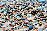pebbles of different colors on the beach closeup