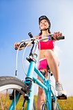woman biker riding Folding Bicycle  with blue sky background