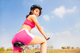 woman biker riding Folding Bicycle and looking back