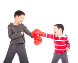 two boys fighting with boxing gloves.