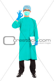 portrait of surgeon or checker in mask and thumb up