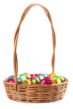 Chocolate eggs in a basket on white