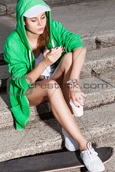beautiful sexy lady in jeans shorts with skateboard, to-go cup a