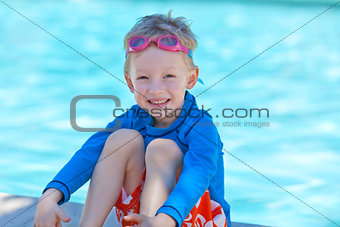 boy by the pool
