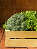 broccoli cabbage and lettuce in a wooden box