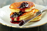 Pancakes with ricotta and cowberry sauce.