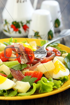 Plate with salad and fork.