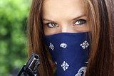 Gun Bandit Woman in Bandanna Holds Black Revolver