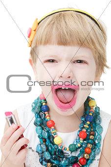 little girl applying lipstick