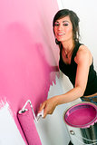 Young Adult Home Maker Paint the Walls Pink with Roller