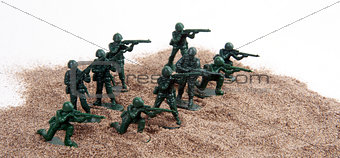 Toy Army Men in Pile of Sand