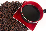 Mocha Java Red Porcelain Coffe Cup Sitting in Roasted Beans