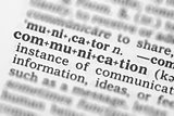 Macro image of dictionary definition of communication