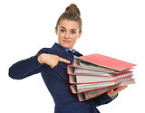 Business woman pointing on stack of folders