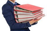Closeup on business woman with stack of folders