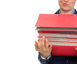 Closeup on doubting business woman with stack of folders