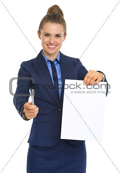 Smiling business woman giving document and pen