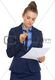 Business woman examining document