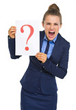 Frustrated business woman showing paper sheet with question mark