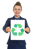 Business woman showing paper sheet with recycle sign