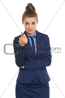 Business woman pointing in camera with pen