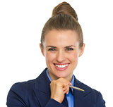 Portrait of smiling business woman with pen