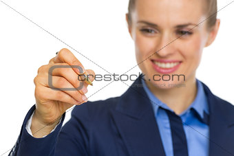 Closeup on business woman writing in air with pen