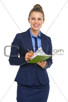 Smiling business woman with notepad