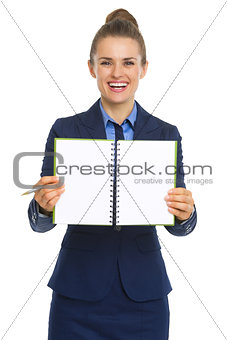 Smiling business woman showing open notepad
