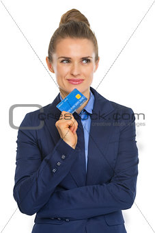 Portrait of thoughtful business woman with credit card