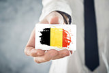 Belgian Businessman holding business card with Belgium Flag