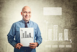 Businessman holding paper with bar chart drawing