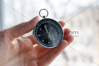 black compass in a female hand
