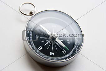 black compass on a white background in perspective