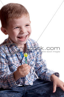 a little boy with candy on a stick