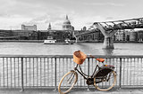 Bike with wicker basket against St Paul's backdrop, London, UK