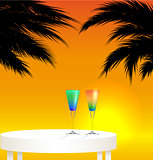 Tropical trip concept ; sunset landscape with two cocktails
