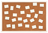 many small sheets of paper on bulletin cork board