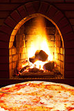 pizza margherita and open fire in oven