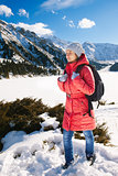 Young woman take a walk on winter mountain slope (Big Almaty Lak