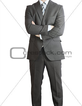 Man in suit standing with the cross arms