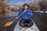 senior canoe paddler