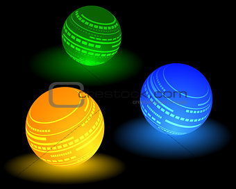 three multi-colored ball