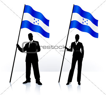 Business silhouettes with waving flag of Honduras