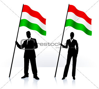 Business silhouettes with waving flag of Hungary