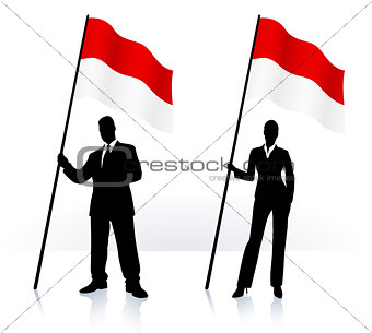 Business silhouettes with waving flag of Indonesia