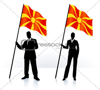 Business silhouettes with waving flag of Macedonia