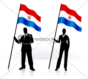 Business silhouettes with waving flag of Paraguay