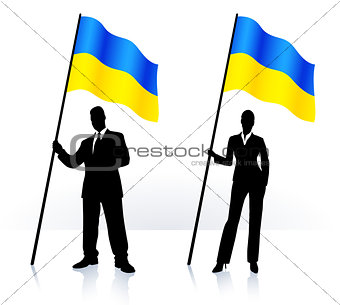 Business silhouettes with waving flag of Ukraine