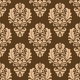 Repeat floral motifs on a brown background